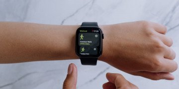 person wearing black smartwatch