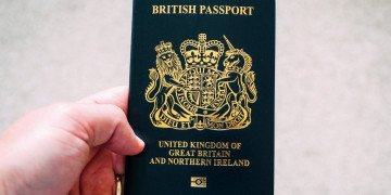 crop unrecognizable person demonstrating british passport