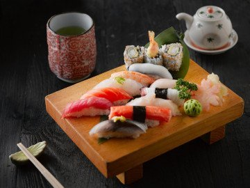 sushi on brown wooden board
